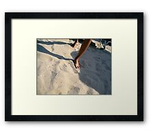 Walking in the sand Framed Print