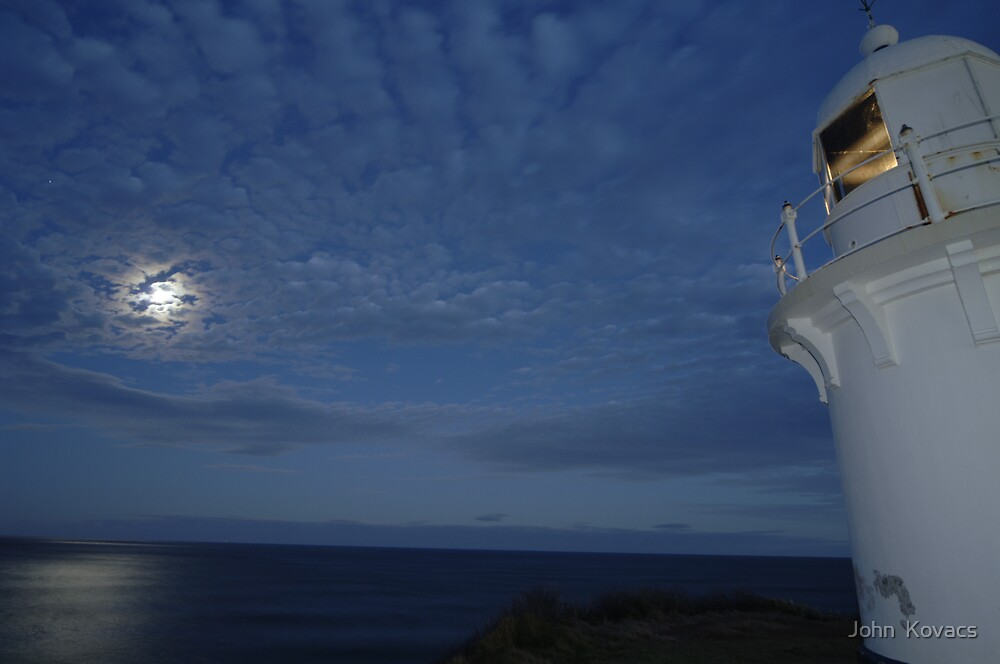 lighthouse at sunset by John  Kovacs
