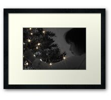 A Childs Glow at Christmas Time Framed Print