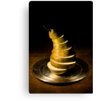 Sliced pear on the silver plate Canvas Print