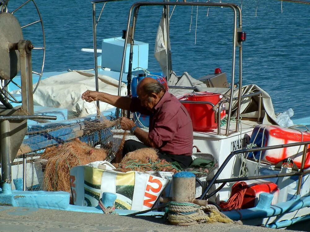 Cypriot Fishermen fixing his nets by Pete Gallagher