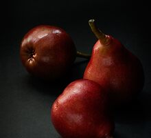 Red pears over dark background by katiawhite