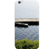 boat moored to old cracked wood bridge  iPhone Case/Skin