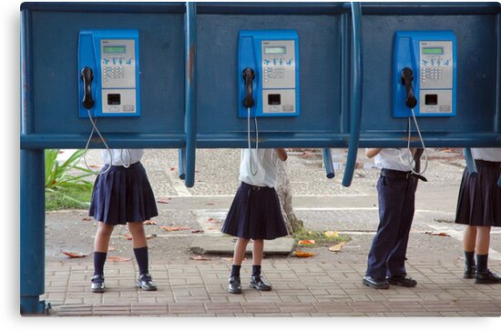 Communication! - School children play with public phone in Costa Rica by Eyal Nahmias