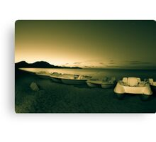 Pedal boats on the beach at night. Canvas Print