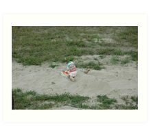 Girl playing in the sand Art Print