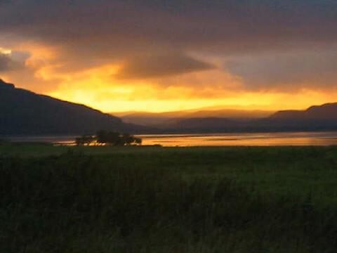 sunset over loch fleet by Nazim
