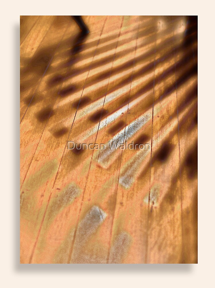 Shadowed floorboards by Duncan Waldron