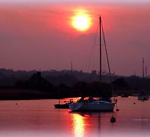 Sun Setting over Topsham Estuary by Charmiene Maxwell-Batten