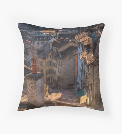 Roofs at sunset Throw Pillow