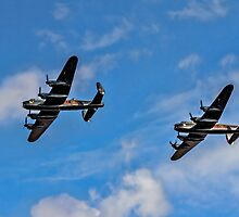 Lancasters PA474 & FM213 in line astern by Colin Smedley