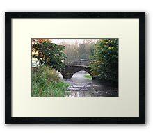 A BRIDGE OVER STEAMY WATER Framed Print