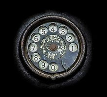 Old black telephone. Close-up of a rotary dial by enolabrain