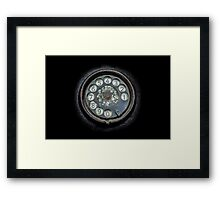 Old black telephone. Close-up of a rotary dial Framed Print