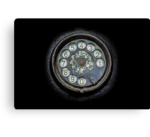 Old black telephone. Close-up of a rotary dial Canvas Print