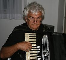 The Old Accordion Player, is not a gentleman.  by MrJoop