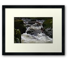 WATER ON THE ROCKS Framed Print