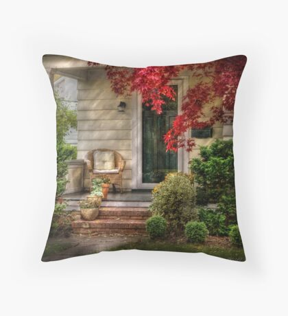 A chair and some flowers Throw Pillow