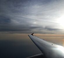 Sunrise Over the Ocean from Aeroplane by Elle Tamata