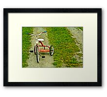Red tricycle Framed Print