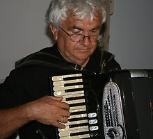 The Old Accordeon Player by Ozcloggie