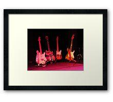 Four Guitars Framed Print