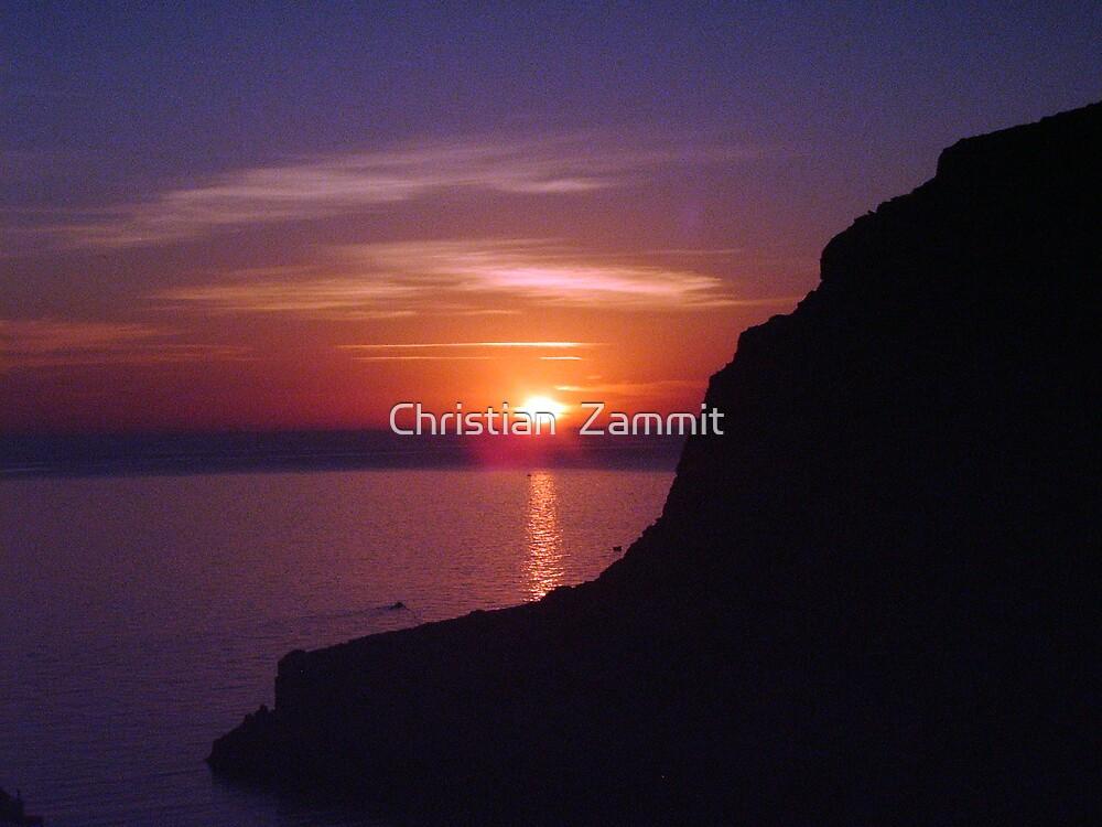 Sunset at Xlendi, Gozo by Christian  Zammit