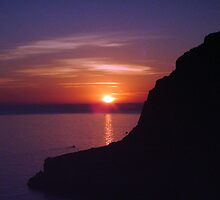 Sunset at Xlendi, Gozo by Christian  Zammit