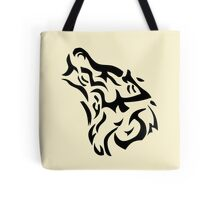 Tribal wolf head on light brown background Tote Bag