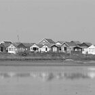 Beach huts in Black and White by Vanessa Combes