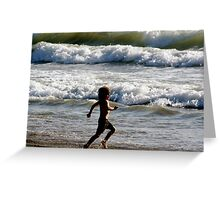 Candid Child playing in the surf Greeting Card