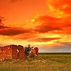 Lone house on fire. by Izak van der Merwe