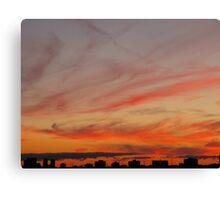 Smoke-ringed sky Canvas Print