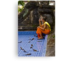 Young Buddhist Monk and his mobile phone  Canvas Print