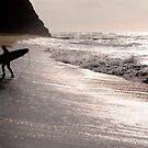 Silhouette of a surfer by Rae Marie Threnoworth
