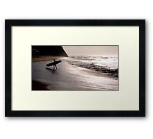 Silhouette of a surfer Framed Print