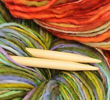 yarn and knitting needles by Ilze Lucero