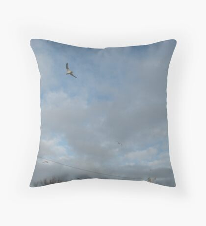 seagull in cloudy skies Throw Pillow