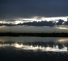 Evening shower, Boeung Kak Lake, Phnom Penh by Thomas Entwistle