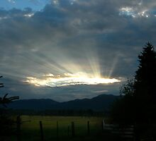 Sunrise through Stormclouds by Janet Houlihan