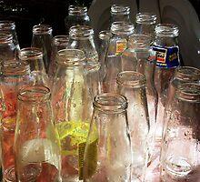 Empty sauce bottles by Alison McDonald