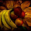 Fruit on Magnolia leaves by GlennRoger