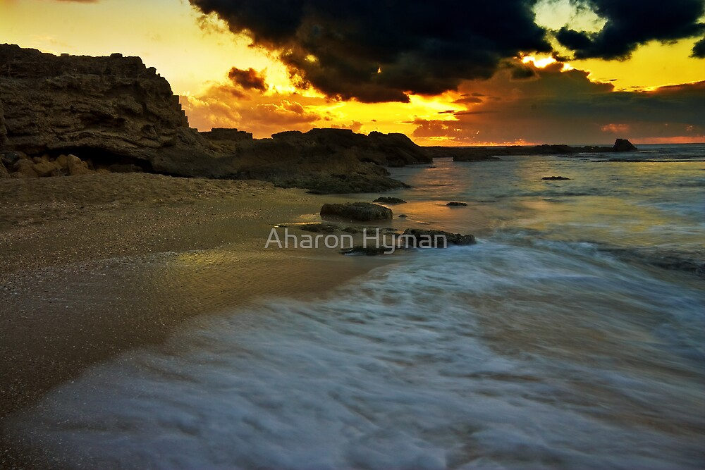 sun sand and clouds by Aharon Hyman