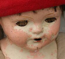 doll head with red cap by David Chesluk