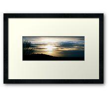 Melting sun Framed Print
