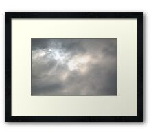 Staring into the Clouds Framed Print