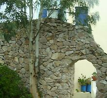 Santorini arch and blue pots by Ann Palmieri