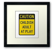 Caution Childish Adult at Play Framed Print