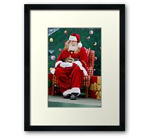 Santas are looking around already Framed Print