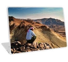 A local beduin looks out over the desert mountains Laptop Skin
